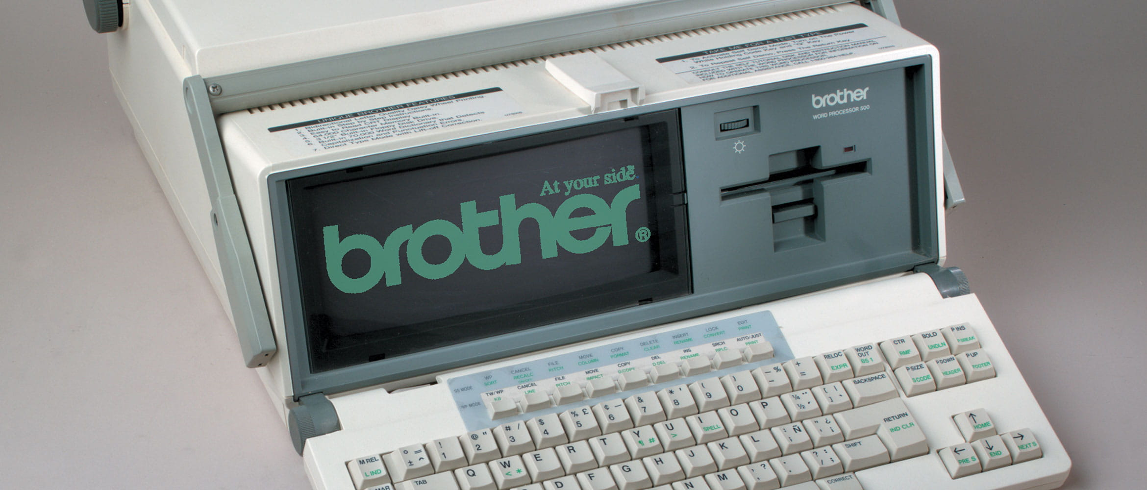 An old word processor machine with Brother logo on the screen