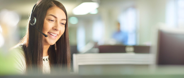 Smiling women speaking on a headset