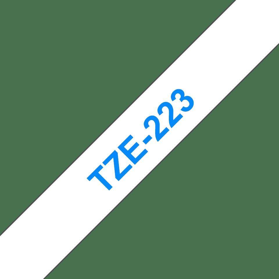 Oryginalna taśma TZe-223 firmy Brother – niebieski nadruk na białym tle, 9mm szerokości 3